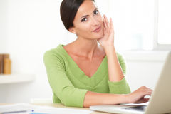 Adult latin woman browsing the web on laptop Royalty Free Stock Images