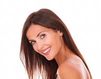 Adult latin woman smiling at camera. Head and shoulders portrait of adult latin woman for body care product smiling at camera on isolated studio Royalty Free Stock Photos