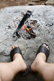 Adult legs at open campfire Royalty Free Stock Images