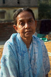ADULT LITERACY. An elder woman to understand the alphabets in a rural area in India Stock Images