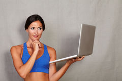 Adult long hair female holding laptop computer Stock Photo