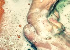 Adult lovers playing with foot in shower stock images