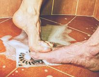 Adult lovers playing with foot in shower stock photography