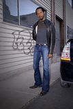 Adult Male. An handsome young adult male standing on a city street Royalty Free Stock Image
