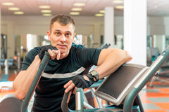 Adult male athlete spends time at gym Royalty Free Stock Photo