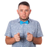 Adult male with beard in a blue bow tie in summer shirt in police handcuffs isolated Stock Photos
