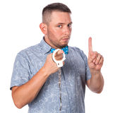Adult male with beard in a blue bow tie in summer shirt in police handcuffs isolated Royalty Free Stock Photography
