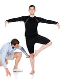 Adult male dancer. Wearing a black shirt and pants and ballet dance instructor. Teacher is assisting the student Royalty Free Stock Images