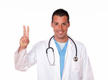 Adult male doctor with winning sign Stock Photography