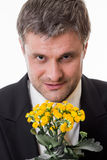 Adult male with flowers. Stock Image