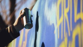 Adult Male Graffiti Artist Paint Spraying the Wall, Urban Outdoors Street Art Concept. Handheld 1920x1080 cinematic toned HD footage stock video footage