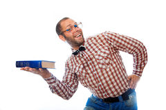 Adult male hipster presents a book and smiling Royalty Free Stock Images