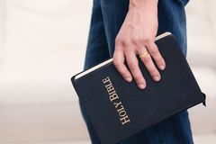 Man Holding Bible to His Side Stock Photos