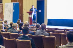 Adult Male Host Speakers Standing in Front of the Audience Durin Stock Image
