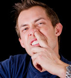 Adult male nose picking Stock Photography