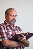 Adult male reading the Bible Stock Images