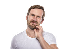 Adult male scratching beard. Royalty Free Stock Photography