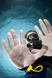 Adult male scuba diver showing his hands. Adult male scuba diver showing the palms of his hands underwater. Focus on the divers' face. Ras Ghozlani, Sharm el Royalty Free Stock Photo