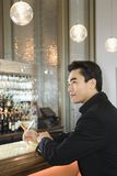Adult male sitting at bar. Stock Photos