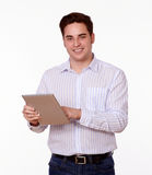 Adult male with tablet pc standing. Portrait of an adult male with tablet pc standing and smiling at you on isolated background Stock Images