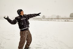 Adult male throwing a snowball Royalty Free Stock Photos