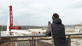 Adult male tourist on observation deck of the Cosmonautics Museum in Kaluga. Looks at the attraction, takes pictures.  Rocket Vost