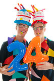 Adult male twins birthday. Identically adult male twins having birthday in studio Royalty Free Stock Image