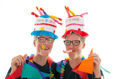 Adult male twins birthday. Identically adult male twins having birthday in studio Royalty Free Stock Photo