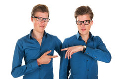 Adult male twins. Identically adult male twins pointing to each other in studio Royalty Free Stock Photo