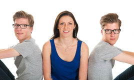 Adult male twins and young girl. Identically adult male twins with girl  in studio Stock Photo