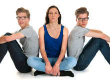 Adult male twins and young girl. Identically adult male twins with girl  in studio Stock Photography