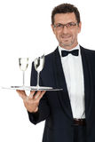 Adult male waiter serving two glass of champagne isolated Stock Photos