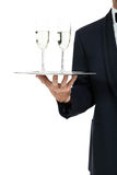 Adult male waiter serving two glass of champagne isolated Stock Photography