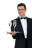Adult male waiter serving two glass of champagne isolated Royalty Free Stock Photos