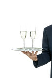Adult male waiter serving two glass of champagne isolated Stock Image
