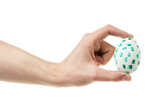 Adult mam hand holding egg Stock Photography