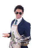 Adult man with an apron holding a cooking pot Stock Images