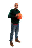 Adult man with basketball. Adult man posing with a basketball in white background Stock Image