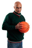 Adult man with basketball. Adult man posing with a basketball in white background Royalty Free Stock Images