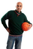 Adult man with basketball Stock Image