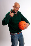 Adult man with basketball. Adult man posing with a basketball in white background Royalty Free Stock Image