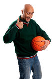 Adult man with basketball. Adult man posing with a basketball in white background Royalty Free Stock Photo