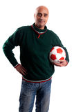 Adult man with basketball. Adult man posing with a basketball in white background Royalty Free Stock Photography