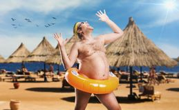 Adult man on the beach Royalty Free Stock Images