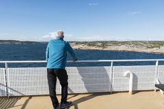 Adult man in blue sweater on ferry Stock Photos