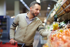 Adult Man Buying Groceries in Supermarket Stock Image