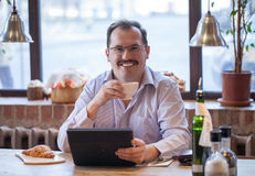 Adult man in cafe Royalty Free Stock Photography