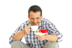 Adult man and cake Royalty Free Stock Images
