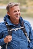 Adult man on a camping holiday looking away smiling, close up, Lake District, UK royalty free stock photos