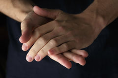 Adult man clasped hands Stock Image